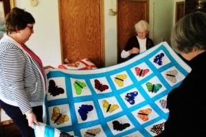 Examining Juanita's butterfly quilt